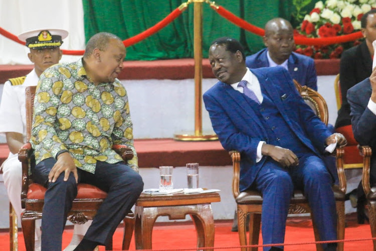 President Uhuru Kenyatta shares a word with ODM leader Raila Odinga during the launch of the BBI Report on November 27, 2019.