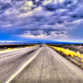 The road less travelled... by Jignashu Parikh - Landscapes Cloud Formations ( clouds, cloud formations, road, travel, infinity )