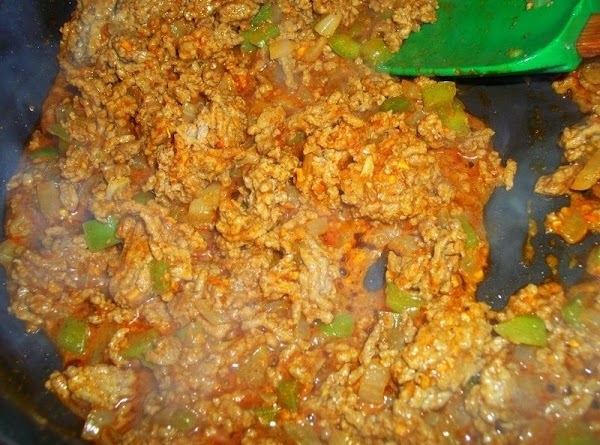 Add 1 1/2 packages of taco seasoning and 1/2 cup water. Simmer for a...