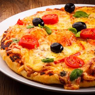 Dr. Davis' Provolone, Prosciutto, and Kalamata Olive Pizza.