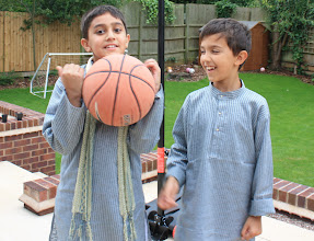 Photo: It takes many tries to get a shot of two boys who would rather be playing basketball.