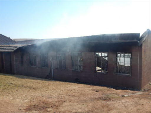An administration housing school records, stationery and expensive equipment including around 15 new computers was gutted in a mysterious fire at Jongintaba SSS in Mqhekezweni village outside Mthatha during the early hours of the this morning. Picture: SIKHO NTSHOBANE