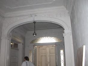 Photo: September 2003 - Month 1: Front Hall - original molding. View of original front doors. Solid wood - no glass! A bit dark.