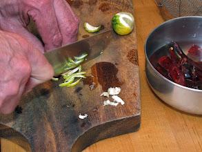 Photo: preparing fresh kaffir lime peel; soaking dried red chillies