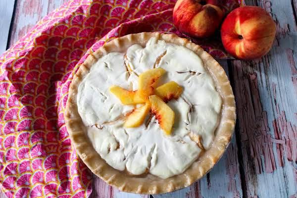 Sour Cream Peach Pie Ready To Be Sliced.