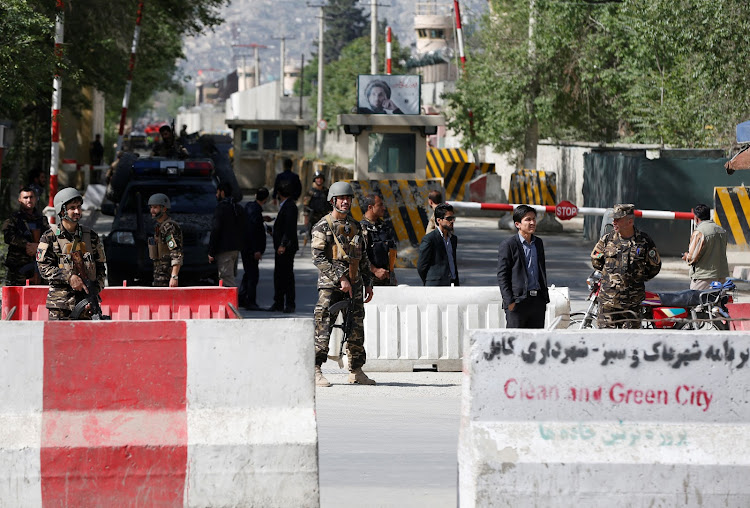 Afghan security forces stand guard near the site of a blast in Kabul, Afghanistan April 30, 2018.