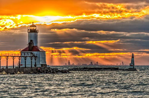 Lighthouse at Sunset by Lynn Kirchhoff - Buildings & Architecture Public & Historical ( clouds, indiana, orange, lighthouse, sea, lake, sun, michigan, sky, sunset, sunrays, pier, chicago,  )
