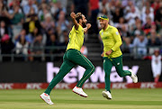 Imran Tahir of South Africa celebrates the wicket of Kamindu Mendis of Sri Lanka during the 1st KFC T20 International match between South Africa and Sri Lanka at PPC Newlands on March 19, 2019 in Cape Town, South Africa.