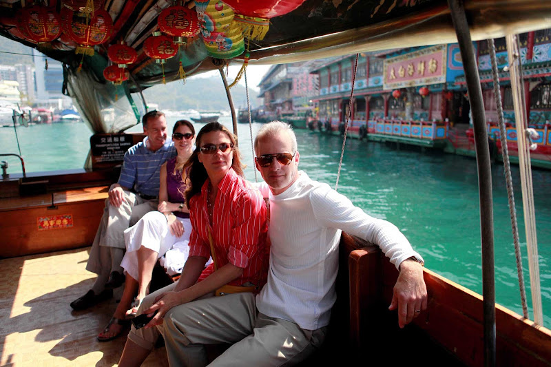 Visitors on a tour boat sail through Aberdeen, Hong Kong.