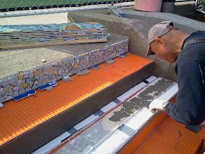 Photo: Third full day of work (October 29, 2013) with KZ Tile worker (Henry) installing the first section of the Hidden Garden Steps (16th Avenue, between Kirkham and Lawton streets in San Francisco's Inner Sunset District) 148-step ceramic-tile mosaic designed and created by project artists Aileen Barr and Colette Crutcher. For more information about this volunteer-driven community-based project supported by the San Francisco Parks Alliance, the San Francisco Department of Public Works Street Parks Program, and hundreds of individual donors, please visit our website at http://hiddengardensteps.org.