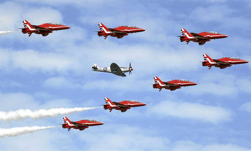 4380316933 The Red Arrows, the Royal Air Force aerobatic team, are joined by a Spitfire