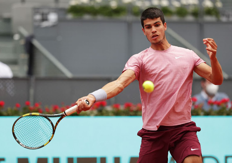 Carlos Alcaraz of Spain hits a forehand during his match against Adrian Mannarino of France at La Caja Magica on May 3, 2021 in Madrid