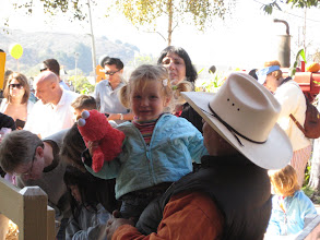 Photo: being transferred to the pony by a cowboy!