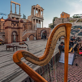 The harp by Petar Shipchanov - Artistic Objects Musical Instruments ( harp, music, plovdiv, rehearsal, theater, amphitheatre, stage, ancient theatre, sky, ancient, bularia, blue, performance, theatre, opera )