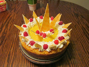 Photo: White Chocolate N' Lemon Cheesecake with Lemon Ganache, white Chocolate and Raspberries.