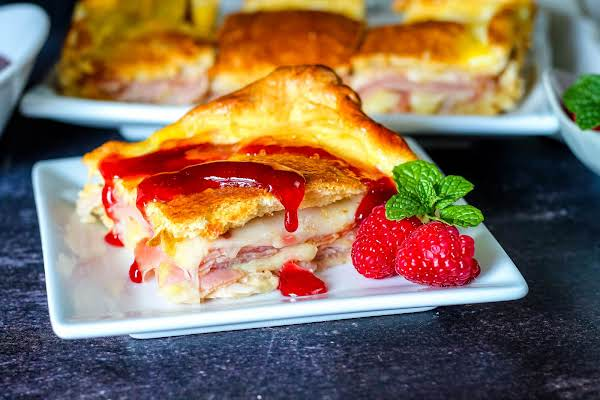 Baked Monte Cristo Sandwiches Drizzled With Raspberry Jam.