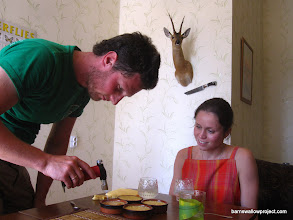 Photo: Georgy puts some finishing touches on homemade creme brulee. Yes, we get the royal treatment before weeks of car camping!