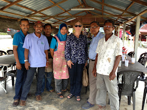 Photo: Lucy, the director of communications at SRI-Rice, Cornell University, with the local farmers.