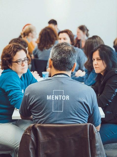 mentor addresses a group
