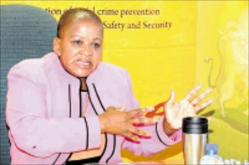 A L E RT : MEC for safety, security and liaison Dikeledi Magadzi speaks to the media about a plan to fight crime. Pic: ELIJAR MUSHIANA. 23/06/2009. © Sowetan.