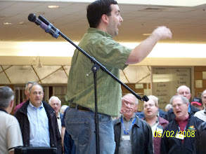 Photo: Andrew Cranston directing Massed Sing - County Fair Mall, New Minas