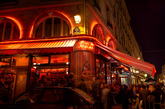 """Photo: The Watering Hole Paris, France. 2011.  My second day in Paris, and I met up with a co-worker, we did a whirlwind tour of paris in a day, and finally we needed some rest and got into a cab and asked him to take us to the latin quarter. Turns out the driver didn't understand english, and we spoke too little french. Finally I just said, """"Drinks and Girls"""", and he nodded, and brought us here.  I guess with enough hand motions and some key words, you can always get your point across.  #Paris2011_RicardoLagos"""