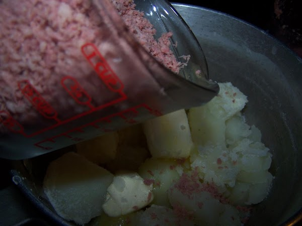 Add butter and corned beef. Stir until well combined.