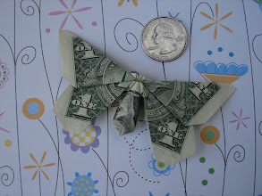 Photo: Model: Dollar Bill Butterfly;  Creator: Michael LaFosse;  Folder: William Sattler;  1 dollar;  Sources: a PDF file but I don't recall where I had downloaded it from; also published in Annual Collection '97 (OrigamiUSA) http://www.origami-usa.org/