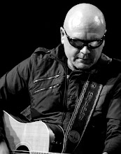 Photo: B/W with Guitar strap with REILLY on it. A gift from Tom Giblin & Colin Wilder
