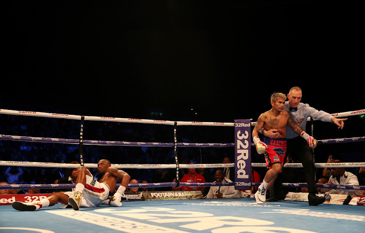 Zolani Tete struggles to get back on his feet after being plummetted by John Reil Casimero.