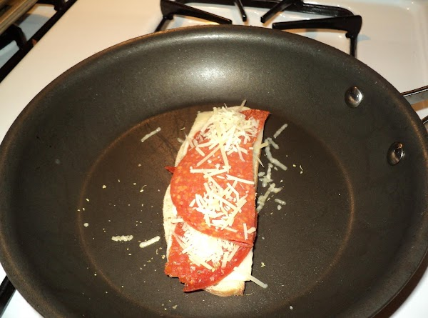 Prepare two slices of ciabatta bread by spreading butter on both pieces of bread..laying...