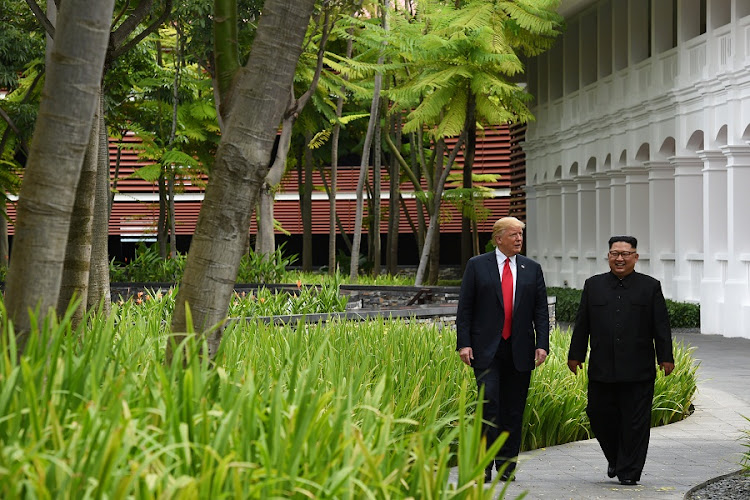 US President Donald Trump and North Korean leader Kim Jong-un walk in the Capella Hotel after their working lunch, on Sentosa island in Singapore on June 12 2018. Picture: ANTHONY WALLACE/REUTERS