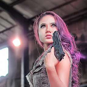 Women with guns by Cevi Permana - People Portraits of Women