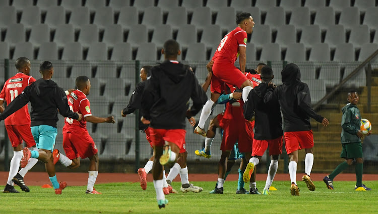 The Magic FC players celebrate after their Nedbank Cup last 32 round penalty shootout win over Macabbi FC at Volkswagen Dobsonville Stadium in Soweto on January 29, 2019 to set up a last 16 tie against Soweto giants Kaizer Chiefs.