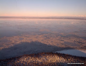 Photo: On final approach, looking across Knik Arm, Denali is again visible at the far left, with the Talkeetna Mountains to the right