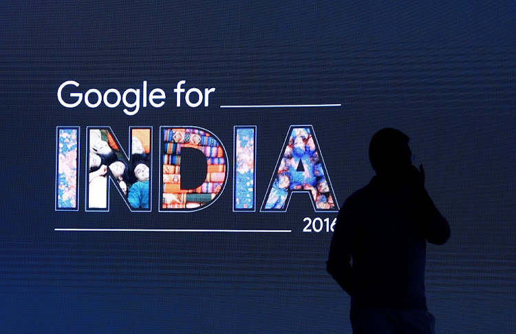 A man stands in front of a screen at a Google event in New Delhi, India. Picture: REUTERS/ADNAN ABIDI