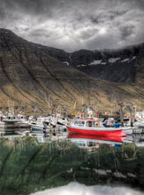 Photo: Red Boat in Fjord Before Storm  As soon as I drove into Isafjordur in the very remote area of NW Iceland, I went right to the docks.  The water was so calm and perfect that it was beyond belief.  I was super-tired, and I thought that the still water MUST be a unique phenomenon, so I toughened up to go take a bunch of photos.  from Trey Ratcliff at http://www.stuckincustoms.com