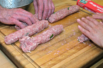 Photo: rolling the pork mixture into fat sausages