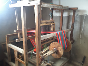 Photo: Wooden loom used daily for alpaca scarves and throws.