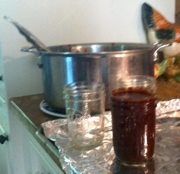 Ladle the hot sauce in hot, clean half-pint or pint canning jars, leaving 1/2-inch...