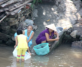 Photo: Year 2 Day 32 - Washing Clothes in the Mekong