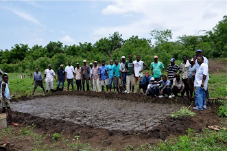Photo: Trained farmers after transplanting their first SRI field; Ferrier, Haiti, June 2010 [Photo by Erika Styger]