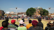 Hostel dwellers wait for police minister Bheki Cele at a park in Jeppestown.