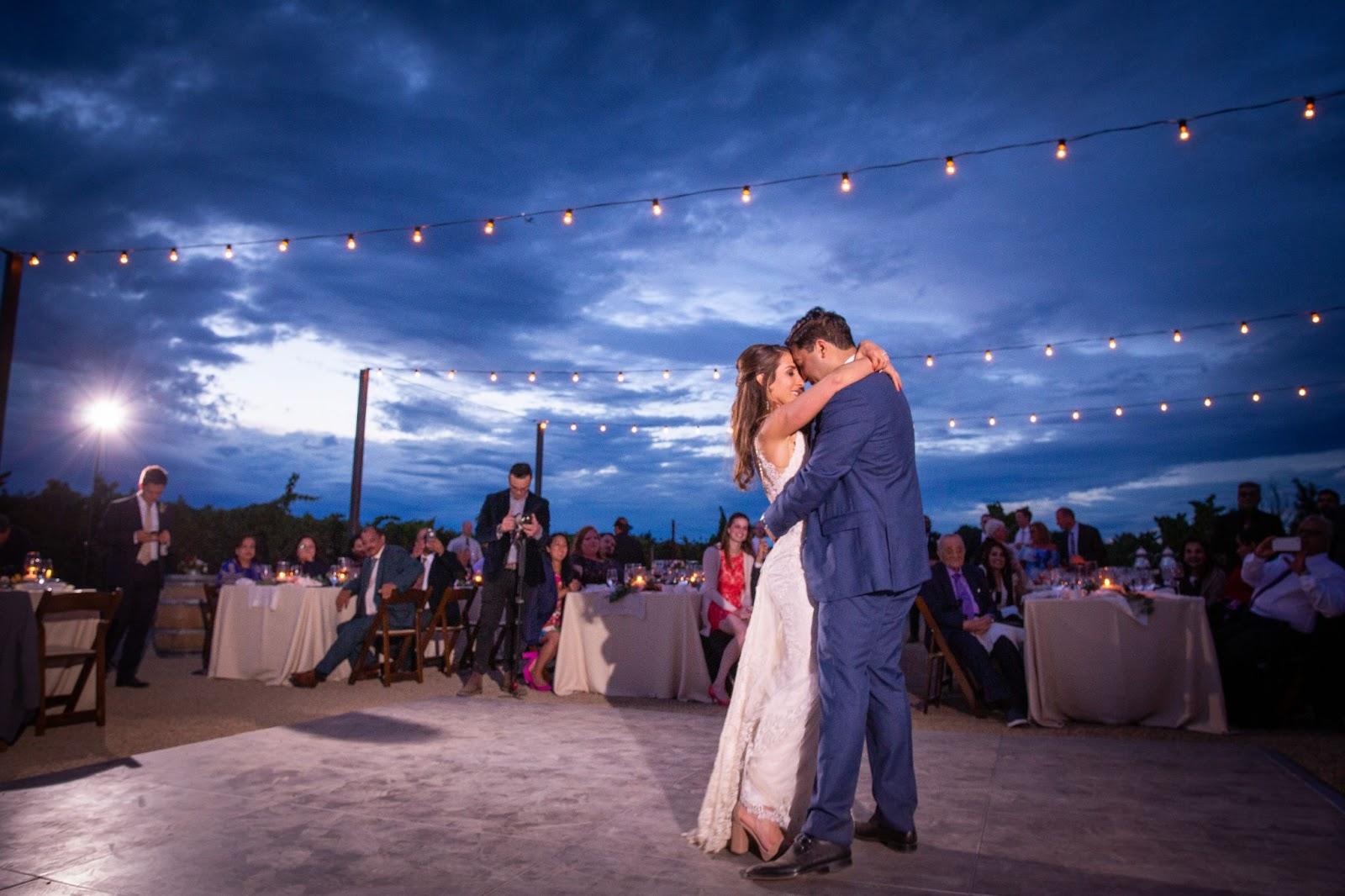 wedding venue dancefloor outside under string lights