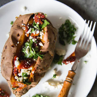 Baked Sweet Potatoes stuffed with feta and sun dried tomatoes.