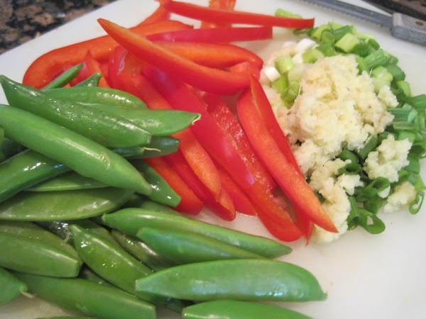 Prepare the vegetables. Microwave the the sugar snaps with a tablespoon of water in...