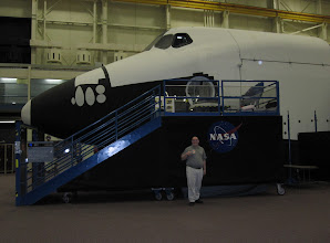 Photo: Travis beside the Full Fuselage Trainer in the Space Vehicle Mockup Facility