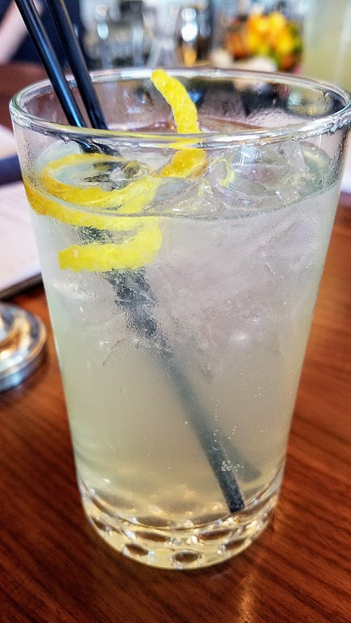 Apfel Spritz with house lemon vodka, Schonaeur Apfel Liqueur, lemon juice, soda, rocks at OP Wurst