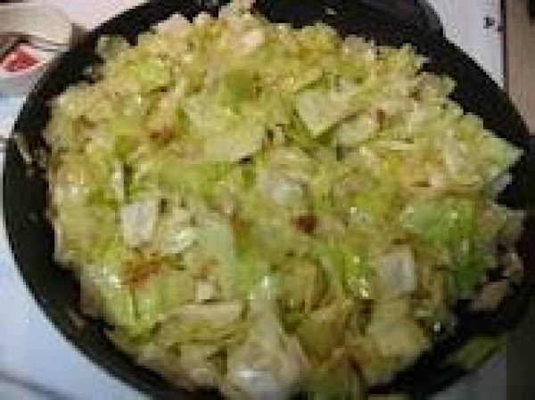 In fry pan with drippings and butter, saute chopped onion. Add cabbage and saute...
