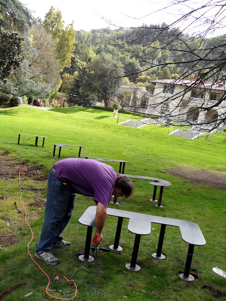 """Photo: Steven Simon installing his work, """"Place,"""" on the Great Lawn. Week of March 30, 2012."""